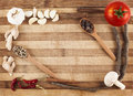 Spices and vegs on cutting board Stock Image