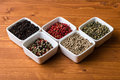 Spices in white square bowls different colorful gourmet Stock Image