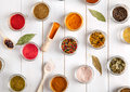 Spices on white wooden background. Food flavor enhancers Royalty Free Stock Photo