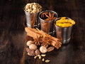 Spices on a wooden board: cardamom, turmeric, cinnamon, nutmeg, star anise Stock Photo
