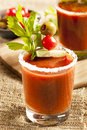 Spicy bloody mary alcoholic drink with a tomato garnish Royalty Free Stock Photography