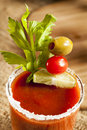 Spicy bloody mary alcoholic drink with a tomato garnish Royalty Free Stock Image
