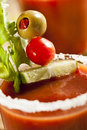 Spicy bloody mary alcoholic drink with a tomato garnish Stock Photography