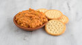 Spicy chicken salad in bowl with butter crackers Royalty Free Stock Photo