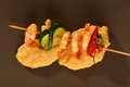 Spicy chili prawn skewers and polenta on corn Royalty Free Stock Image