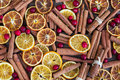 Spicy Christmas background. Cinnamon, oranges and cranberry.