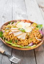 Spicy dried curry instant noodles or malaysian style maggi goreng mamak asian cuisine ready to serve on wooden dining table Royalty Free Stock Photos