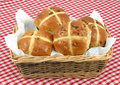 Spicy easter hot cross buns basket red white gingham table cloth Royalty Free Stock Photos