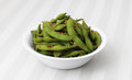 Spicy edamame cooked and spiced soybean pods in a white bowl Royalty Free Stock Photography