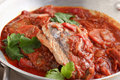 Spicy fish dish a of with tomatoes Royalty Free Stock Photo