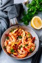 Spicy garlic chilli Shrimps on frying pan with lemon and cilantro Royalty Free Stock Photo