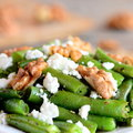 Spicy green beans salad with cottage cheese and walnuts. Summer green beans recipe. Closeup