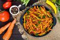 Spicy  green beans stewed with onions, carrots in tomato sauce. Royalty Free Stock Photo