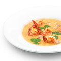Spicy healthy thai tom yum soup on white served with royal shrimps and herbs Royalty Free Stock Images