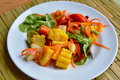 Spicy mixed fruit and vegetable salad on dish Royalty Free Stock Photo