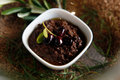 Spicy olives pate made ​​from with spices Royalty Free Stock Images