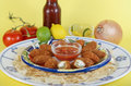 Spicy party platter jalapeno poppers on blue and white hispanic design with salsa and tortilla chips and ice cold beer surrounded Stock Images