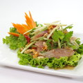 Spicy salad with ferment sausage or sour pork Royalty Free Stock Photo