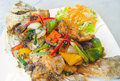 Spicy sea bass fried with black pepper on white plate Stock Photo