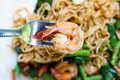 Spicy shrimp noodles the close up in basil Stock Images