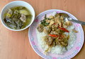 Spicy stir fried chicken with basil leaf and pickled cabbage soup Royalty Free Stock Photo