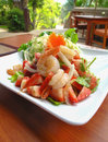 Spicy strawberry seafood salad thai food style fresh yum on white plate Royalty Free Stock Photos