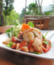 Spicy strawberry seafood salad thai food style fresh yum on white plate Royalty Free Stock Images