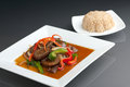 Spicy thai eggplant and brown rice a beautifully presented dish of food with mixed vegetables beef Stock Photography