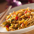 Spicy thai noodles with chopsticks. Stock Photography