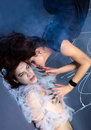 Spider girl and victim Royalty Free Stock Photo