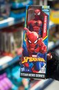 Spider man figurine in hand of woman in a toys store supermarket Royalty Free Stock Photo
