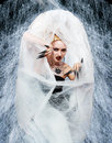 Spider queen portrait of girl with on web bodyart acting as getting out from the cocoon Royalty Free Stock Photo