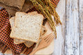 Spike and whole wheat bread on white wooden table background soft focus Stock Image