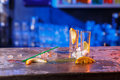 The spilled cocktails with ice cubes on blue color Royalty Free Stock Photo