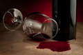 Spilled glass of wine on table after party