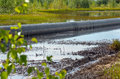 Spilled oil around the pipeline environmental pollution Royalty Free Stock Photos