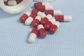 Spilled pills and white bottle Royalty Free Stock Photo
