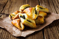 Spinach and cheese puff pastries triangles on paper Royalty Free Stock Photos