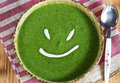 Spinach cream soup smile Royalty Free Stock Photos