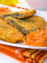 Spinach cutlet on white dish. Royalty Free Stock Images