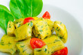 Spinach gnocchi with melted butter and cherry tomatoes from the garden Stock Photography