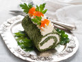 Spinach rol roll with cream cheese and caviar selective focus Royalty Free Stock Photos