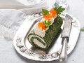 Spinach roll with cream cheese and caviar selective focus Royalty Free Stock Photo