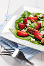 Spinach salad with strawberries goat s cheese and pecan nut Royalty Free Stock Photography