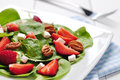 Spinach salad with strawberries goat s cheese and pecan nut Royalty Free Stock Images