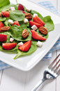 Spinach salad with strawberries goat s cheese and pecan nut Stock Images