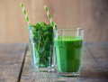 Spinach smoothie on wooden table Royalty Free Stock Photo
