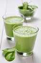 Spinach smoothies in glass on a wooden background Royalty Free Stock Photos