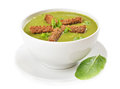 Spinach soup with dried crusts on white background Royalty Free Stock Photo