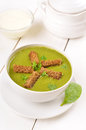 Spinach soup with dried crusts in white bowl Royalty Free Stock Images